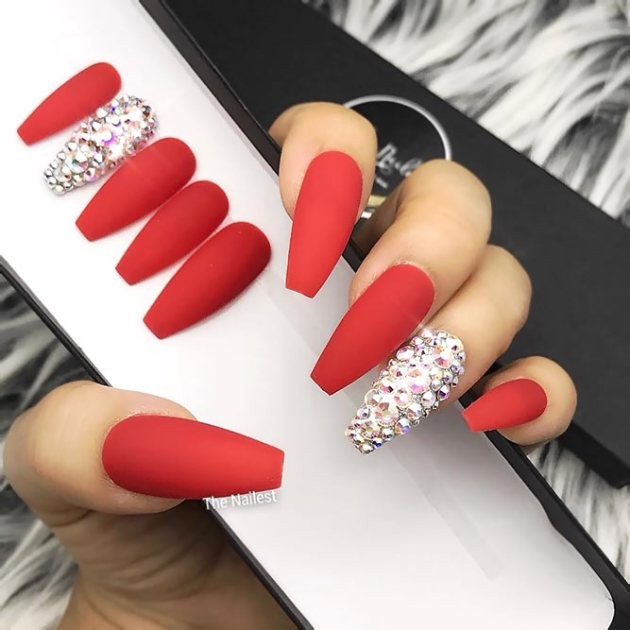 red coffin nails with rhinestones on single finger