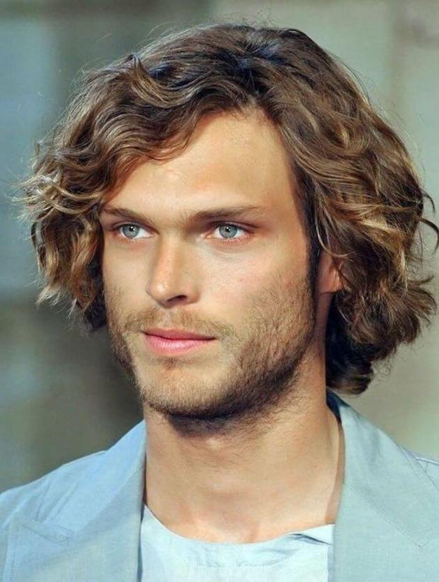 medium length side-parted curly hairstyle