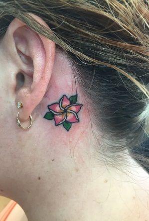 plumeria flower tattoo design behind ear
