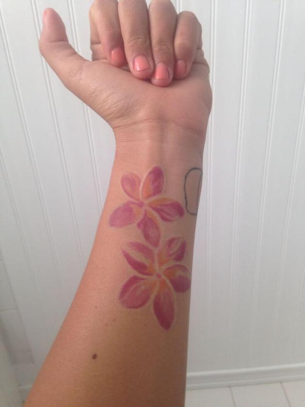 plumeria flowers tattoo design on wrist