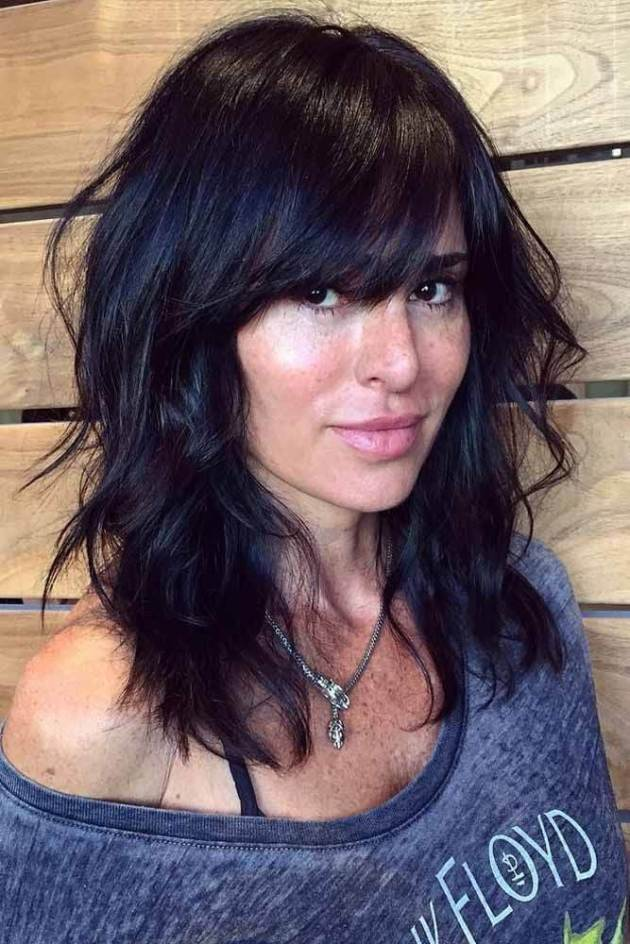 thick shoulder length layered hairstyle with bangs