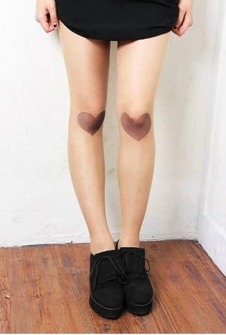 thumb print heart tattoos on knee cap