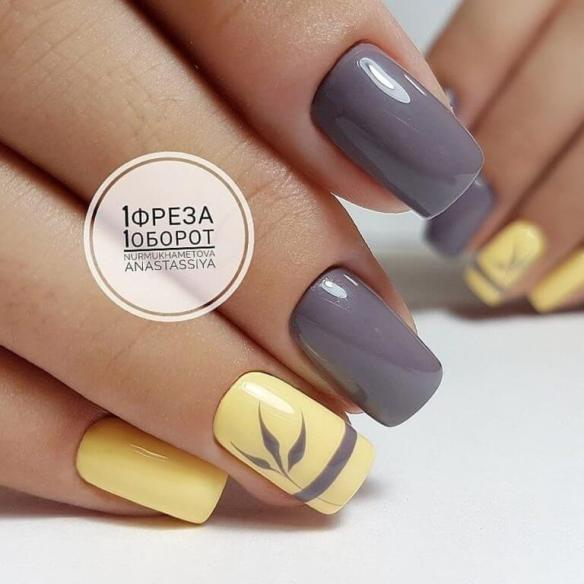 bright grey and pale yellow nails