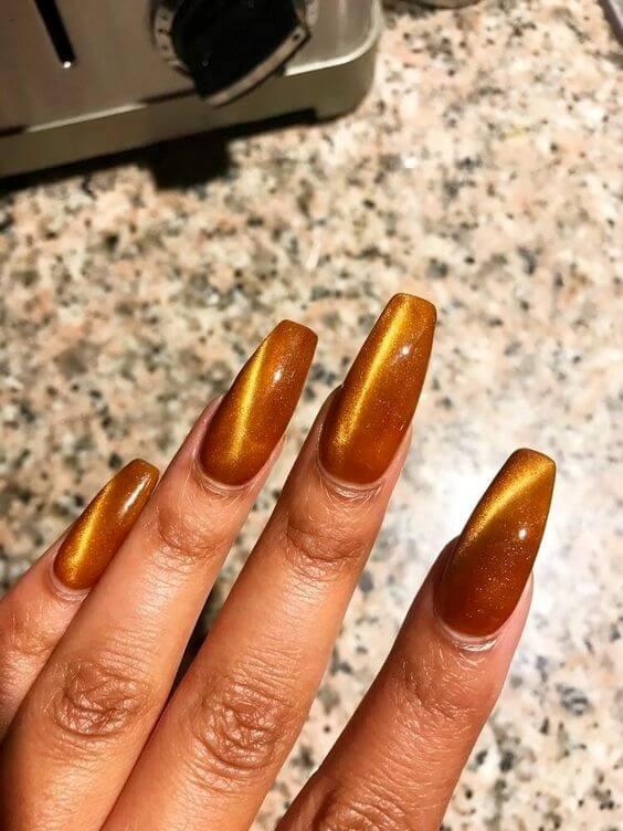gold cat eye nails