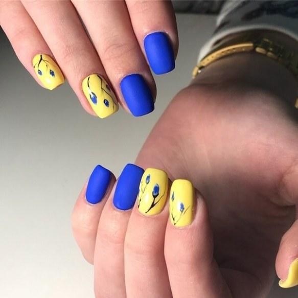 yellow and blue matte manicure