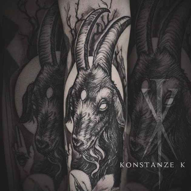 black goat tattoo on arm