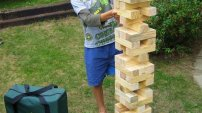 Giant Jenga is safe for children and builds just over 1 meter high.