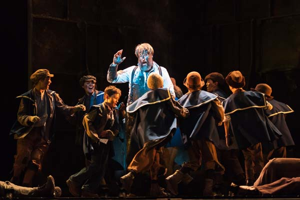 John Owen Jones with the water boys in a scene from Tiger Bay - The Musical at Wales Millennium Centre. Photo: Polly Thomas