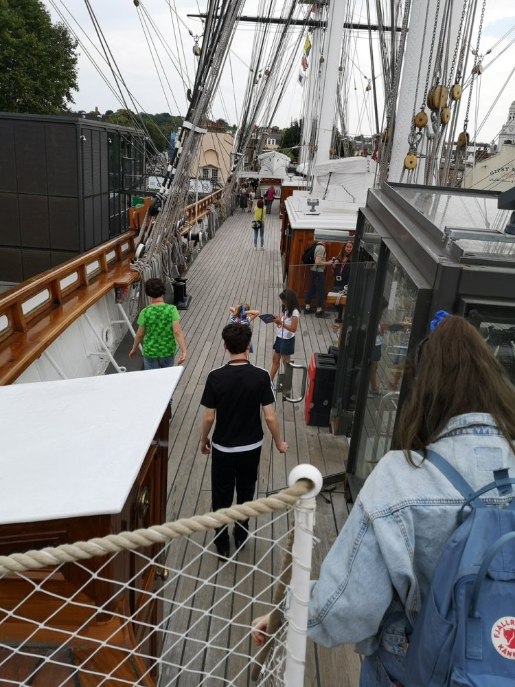 Exploring the upper deck of the Cutty Sark in Greenwich.