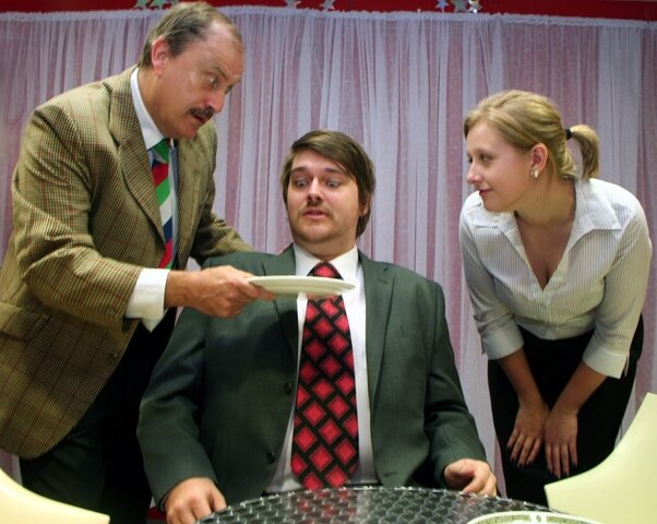 Alex Wilson as Basil and Cathy Morgan as Polly deal with a potentially awkward situation in Fawlty Towers at Newport's Dolman Theatre in 2011. Photo: Phil Mansell