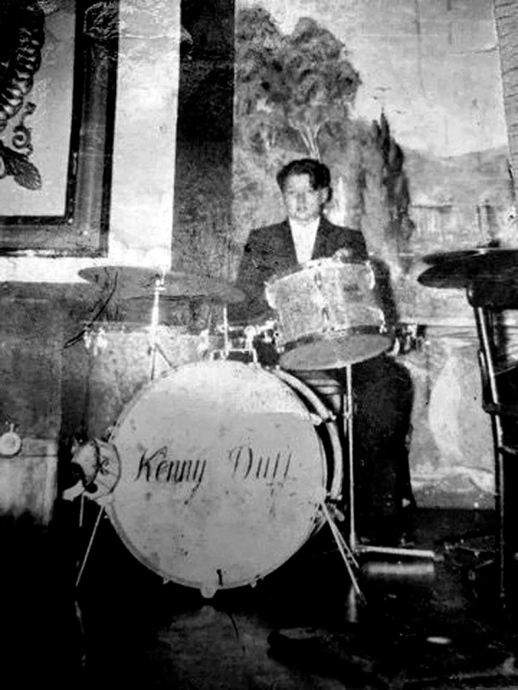 A young Mark Goodwin posing on Kenny Duff's drums at Butlins in North Wales in the 1950s. Photograph courtesy of Mark Goodwin Collection.