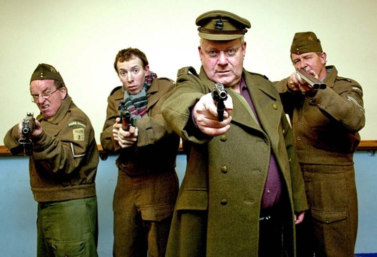 Richard Dymond leads the way as Captain Mainwaring with Rob Jacob (Lance-Corporal Jones), Ryan salter (Private Pike) and Eammon Corbett (Sergeant Wilson)at the rear in Newport Playgoers Dad's Army in 2013 (Photograph: Phil Mansell)