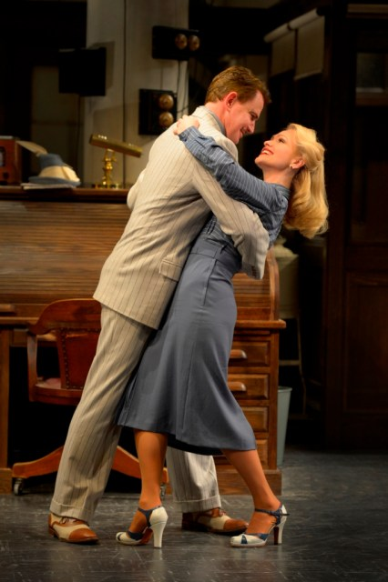 """Douglas Sills as """"Walter Burns"""" and Jenn Lyon as """"Hildy Johnson"""" in La Jolla Playhouse's production of HIS GIRL FRIDAY, by John Guare, adapted from the Ben Hecht and Charles MacArthur play The Front Page and the Columbia Pictures film His Girl Friday, directed by Christopher Ashley, running May 28 - June 30 in the Mandell Weiss Theatre; photo by Kevin Berne."""