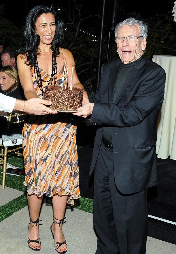 Soraya Nazarian presenting Birthday Cake to Author, Amos Oz