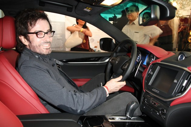 Oscar winner George Chakiris loving the feel of the Maserati, sponsor of the Valentine Romance Style Lounge