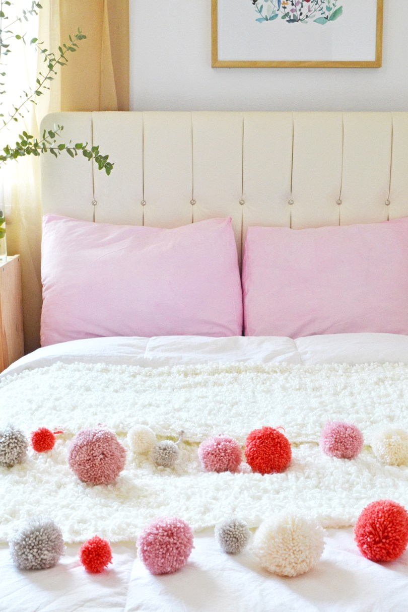 Find out how to make a DIY crochet pom pom blanket at Mollie Makes