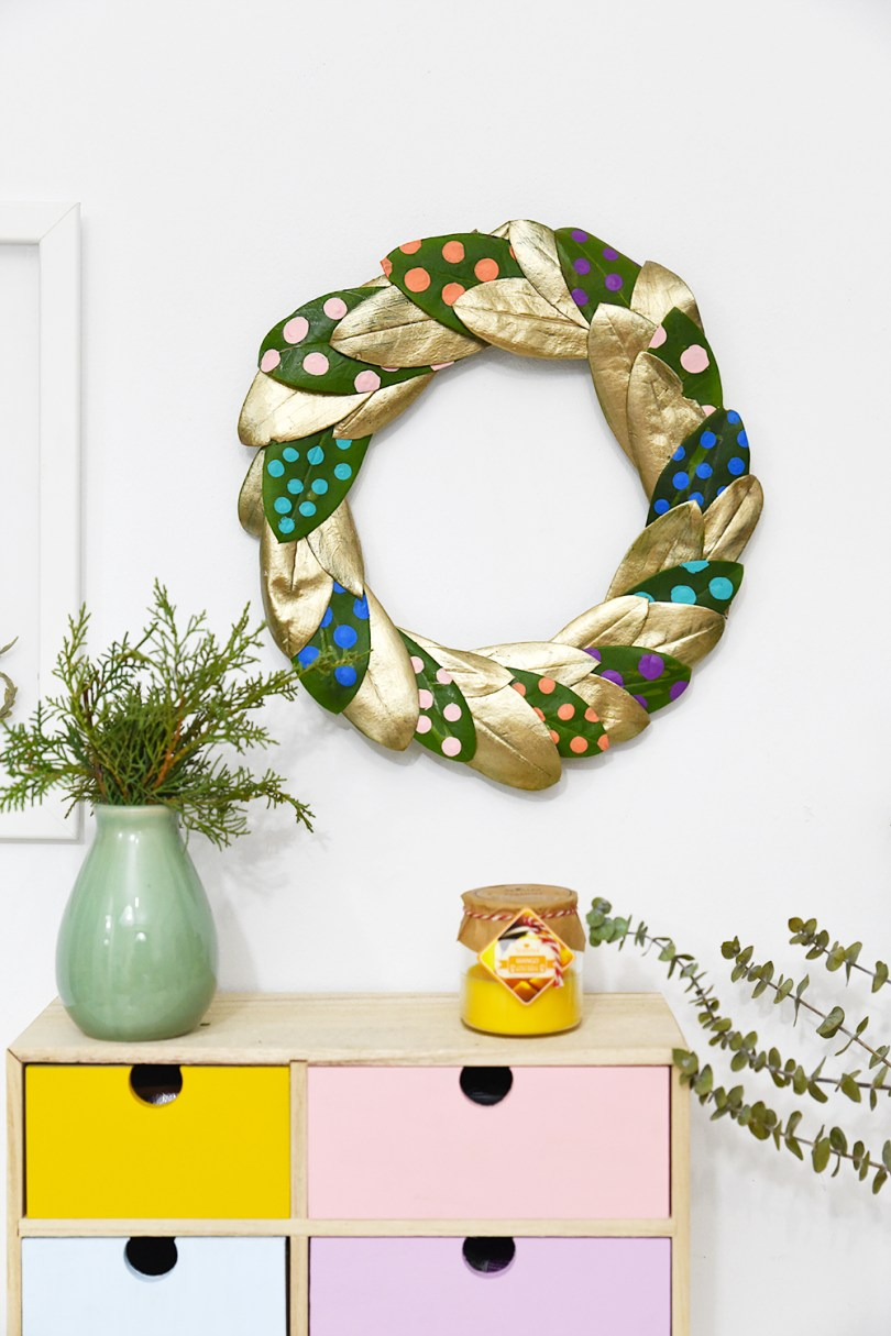 Go for an unconventional method and make this dotted and golden wreath this holiday season that you may use all year long (video available)
