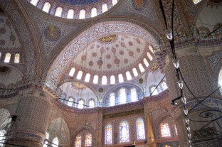 Looking up into the domes inside the Blue Mosque, covered in colourful decorative patterns.