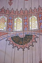 Another decorative text panel near some stained glass windows inside the Blue Mosque