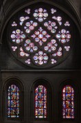 From inside, with its three lancet windows below, the rose window of Lausanne cathedral is a bright jewel box