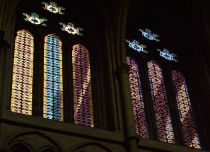 Yellow, pink, and blue patterned windows in Lyon Cathedral