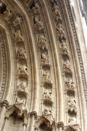 Many small headless sculptures round the porch of Lyon Cathedral