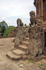 The final flight of stairs to the top of Bakong, guarded by stone lions