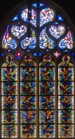 Bright and colourful, this pretty window from Ltons Cathedral is a strange mixture of traditional Christian imagery at the to, and more modern-looking purabstract patterns below.