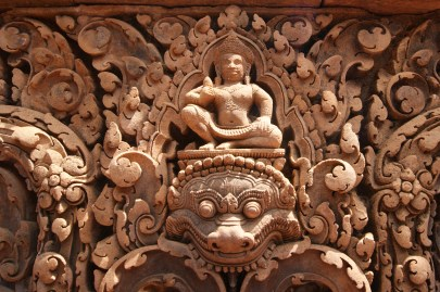 The Hindu god Shiva, known at 'The Destroyer' sitting above a deity representing death.