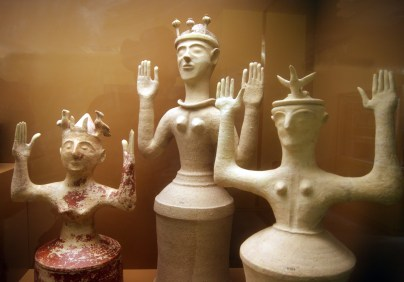 These goddess clay figures, depicted as usual with their arms upraised, are from around 1200 BC, towards the end of the Minoan civilisation. The one on the left has horns and two birds on her head, the one on the right just one bird, and the one in the middle has opium poppy pods, which could also account for the decline of the Minoans.