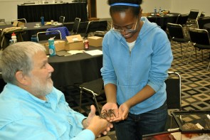 A teacher in attendance at the Entomological Foundation's 2017 STEMbugs Workshop meets a tarantula, with facilitator John Guyton, Ph.D., of Mississippi State University.