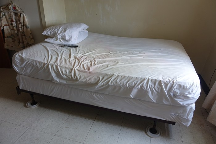 bed after installing encasement and interceptors under the bed legs