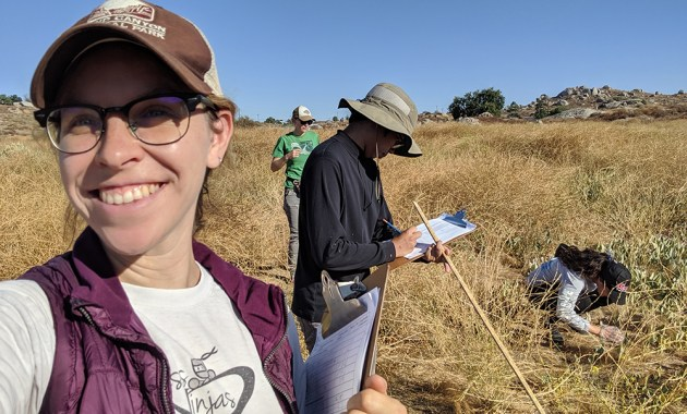 Tessa Shates and students at field site
