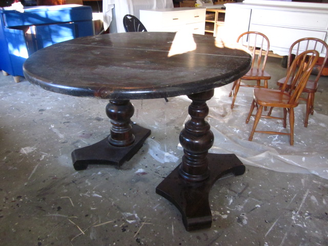 Oval dining table black stain