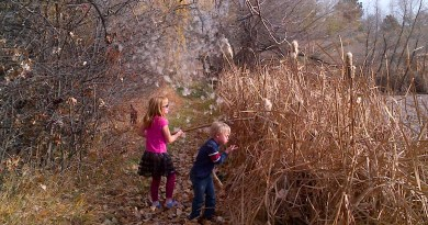 Two kids exploring outside. It looks like it is autumn