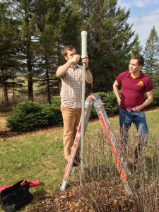 Brian Smoliak and Phil Mykleby install temperature sensor
