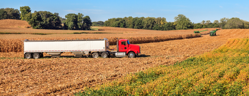 A truck driving in a field
