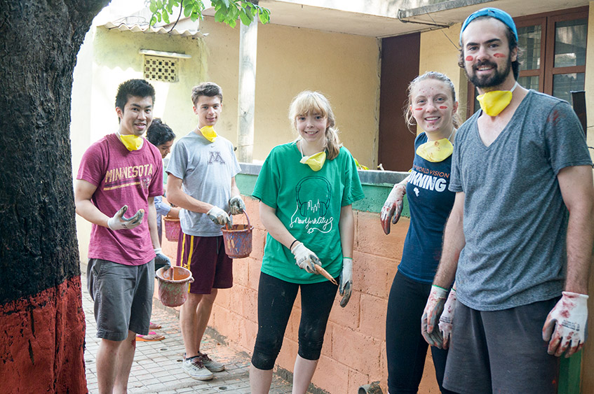 students paint in India