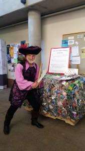 Dana sports a pirate costume to engage in discussions about recycling