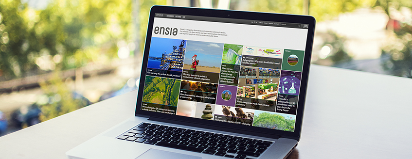 Laptop with Ensia website on screen