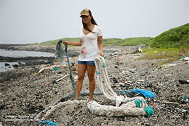 Angela Sun with Fishing Nets on Midway Island, Plastic Paradise LLC