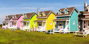 identical brightly colored houses in a row