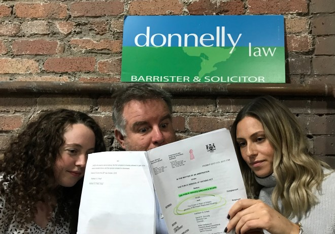 Lawyer David Donnelly and his associates, Sara Gray (left) and Alex Whyte react to the court's decision in favour of Victor Doyle.