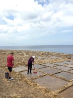 Xwejni – cleaning the salt pans to start the season.
