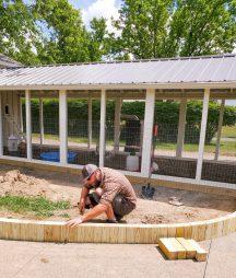 Crew member installing edible landscape