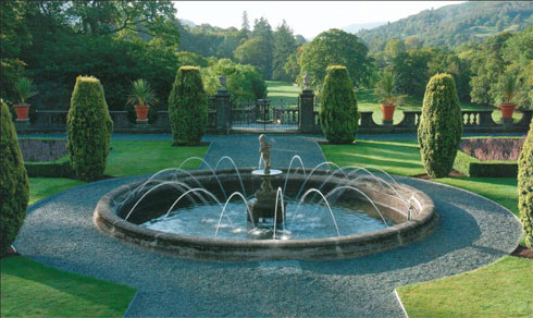 Figure 2: Detail of the upper terrace, Rydal Hall. Designed in 1909 this garden has been recently restored. In spite of the influence of the Arts and Crafts Movement on him, Mawson was not above using moulded concrete for the balustrades and the large pots. From: Waymark, Thomas Mawson, 46.