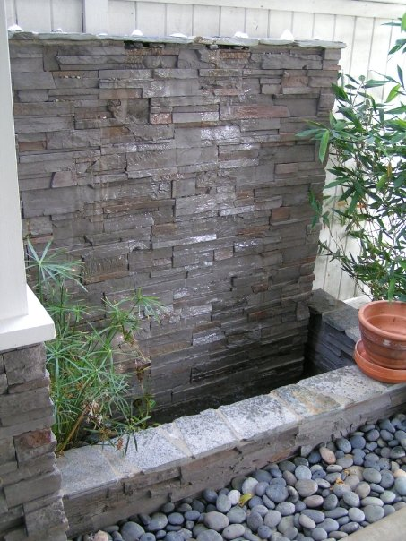 Waterwall features landscaping manhattan beach for How to build an outdoor water feature