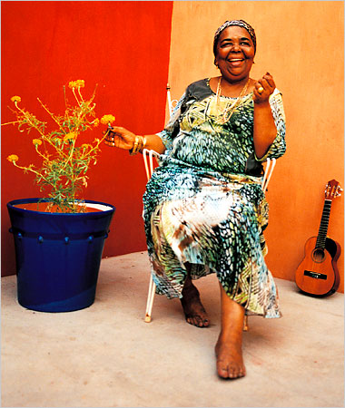 Cesaria, The Barefoot Diva, pauses between songs to enjoy her beautiful flowers.