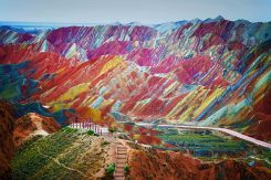 """A visitor stands at a viewing platform in the Zhangye Danxia Landform Geological Park in Zhangye, northwest Chinas Gansu province, 22 September 2012."""