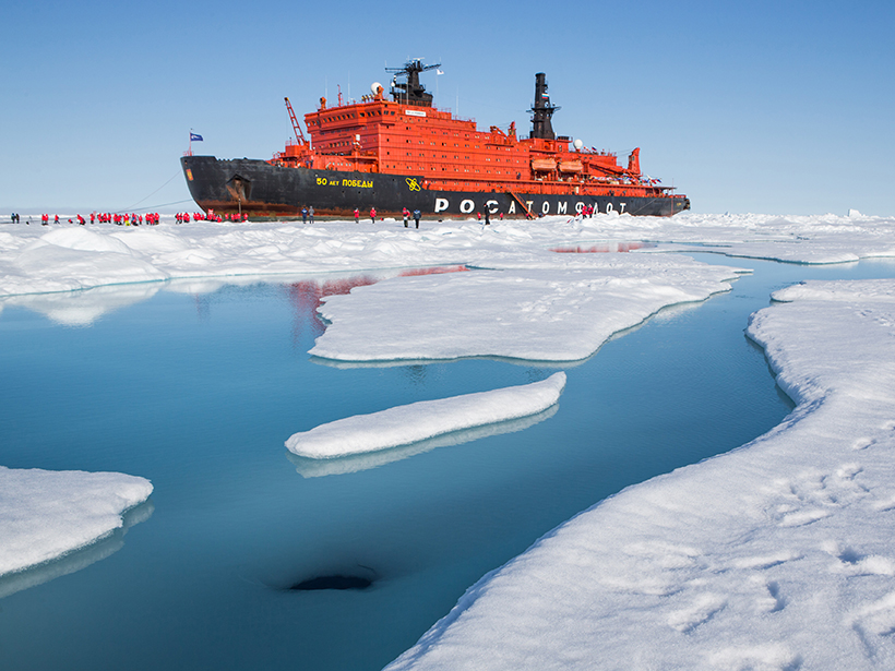 Citizen scientists examine melt pond at North Pole.